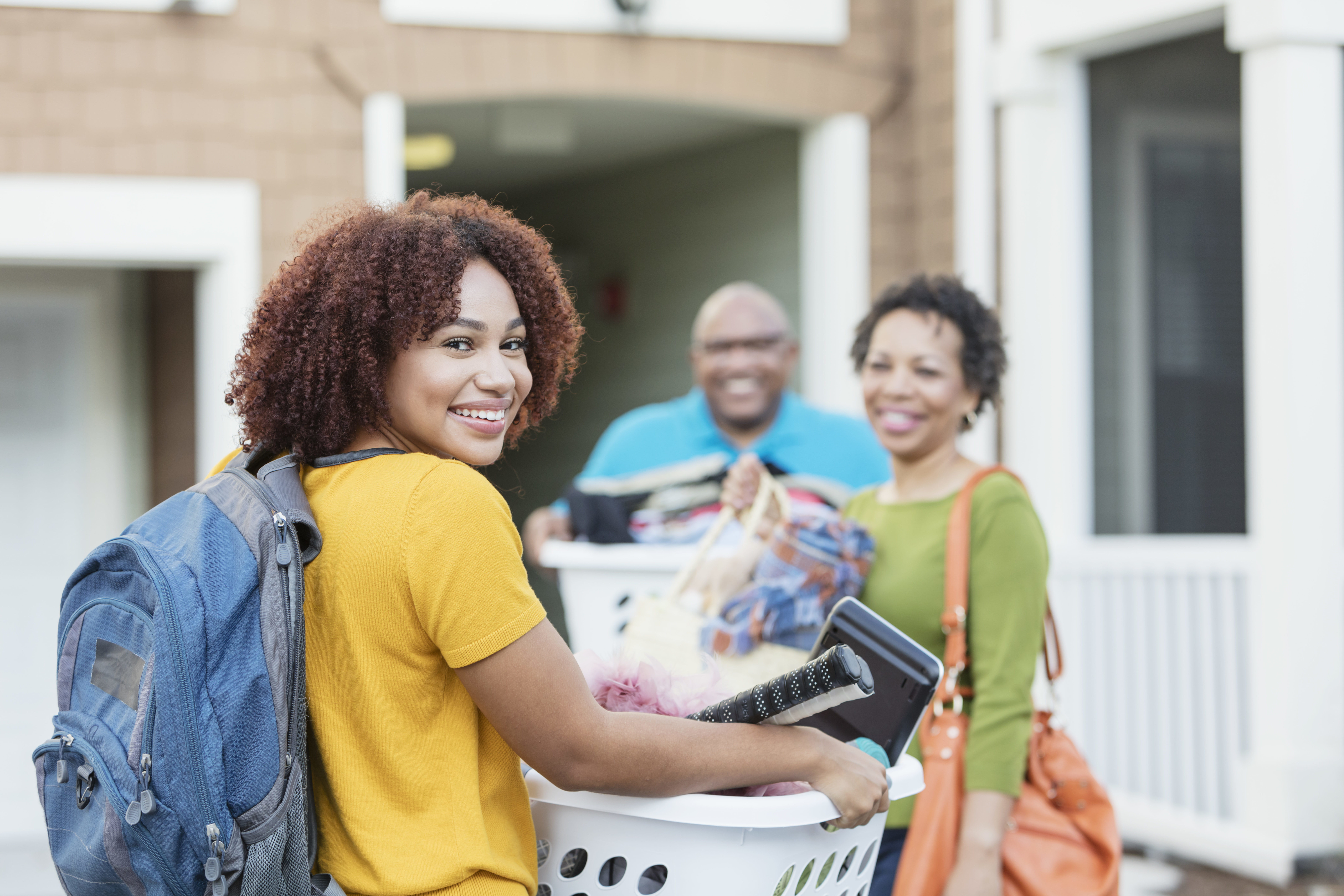 Female student moves in to a residence hall