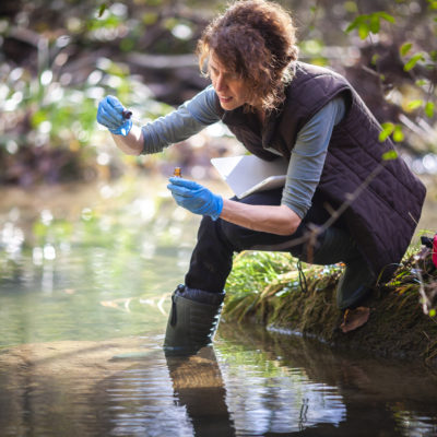 Conservation biology student gathering water samples