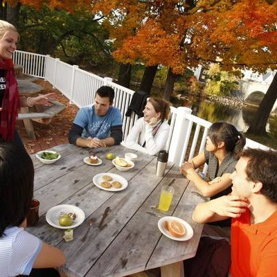 Students on the patios of Gilmore Dining Hall in Henniker