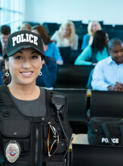 Female police officer speaks to class