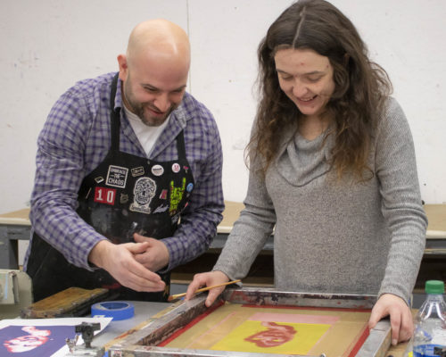 Faculty and student working in the printmaking lab